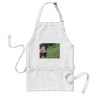 Hand holding a smart phone and nature background adult apron
