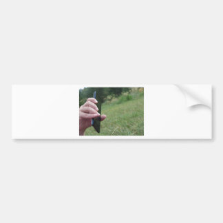 Hand holding a smart phone and nature background bumper sticker