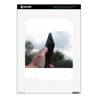 Hand holding a smart phone and nature background iPad 3 skin