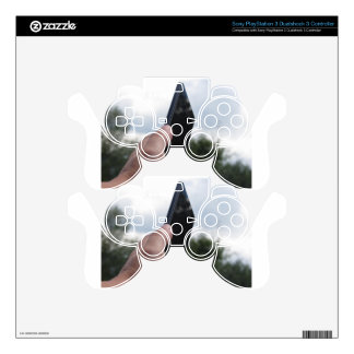 Hand holding a smart phone and nature background PS3 controller decal