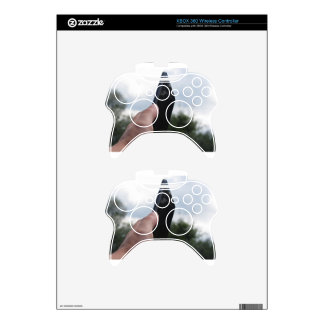 Hand holding a smart phone and nature background xbox 360 controller skin