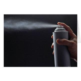 Hand holding Aerosol spray can Card