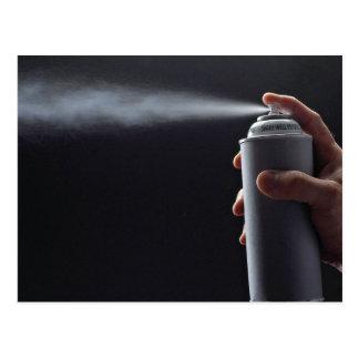 Hand holding Aerosol spray can Postcard