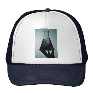 Hand holding an attractive laboratory beaker hat
