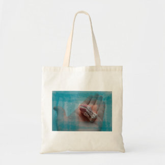 hand holding barnacle seashell teal tote bag