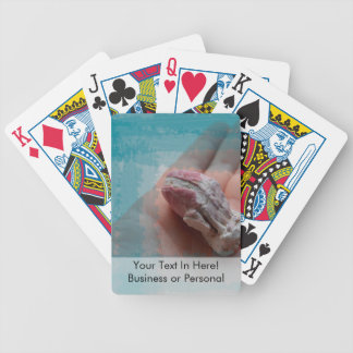 hand holding barnacle seashell teal bicycle playing cards