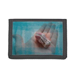 hand holding barnacle seashell teal tri-fold wallet