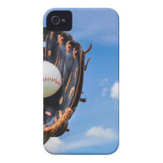 Hand holding baseball in glove with blue sky iPhone 4 cover