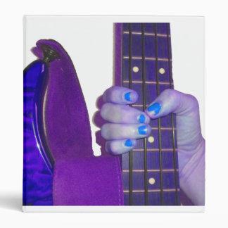 Hand holding bass guitar blue and purple photo binders