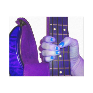 Hand holding bass guitar blue and purple photo canvas print
