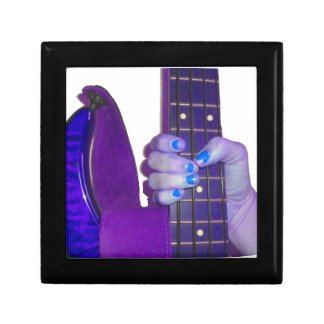 Hand holding bass guitar blue and purple photo jewelry box
