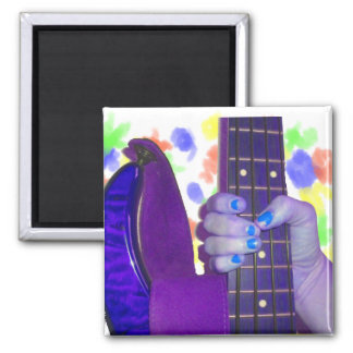 Hand holding bass guitar blue and purple photo refrigerator magnets