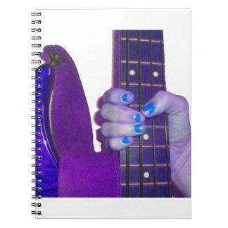 Hand holding bass guitar blue and purple photo notebook
