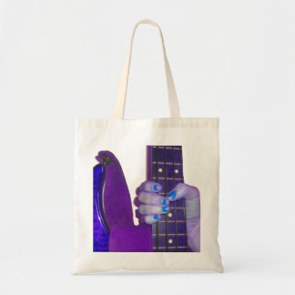Hand holding bass guitar blue and purple photo tote bag
