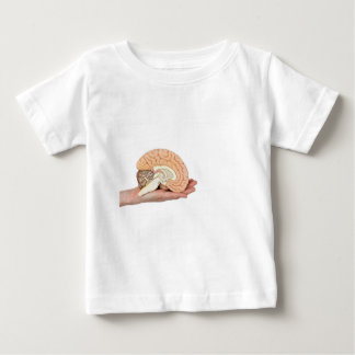 Hand holding brain hemisphere on white background baby T-Shirt