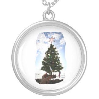 Hand Holding Christmas Tree Beach Sky Ocean Round Pendant Necklace