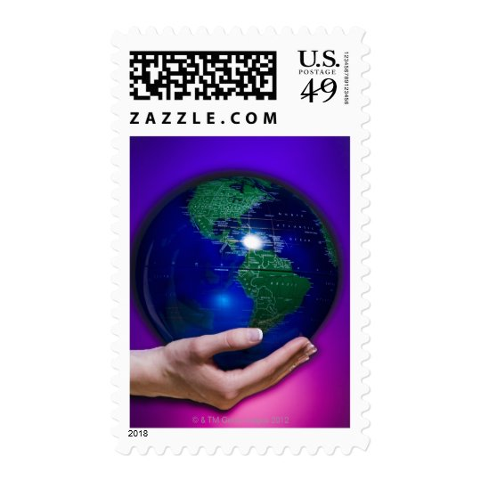 Hand holding earth postage