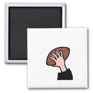 hand holding football 2 inch square magnet