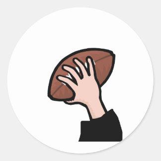 hand holding football classic round sticker