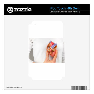 Hand holding heart model in front of chest decal for iPod touch 4G