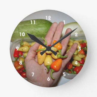 hand holding hot peppers food image round clock