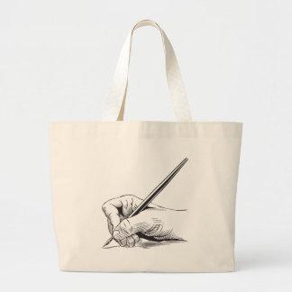 Hand holding pen bag