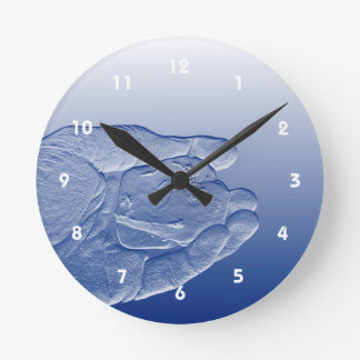 hand holding pepper raised  blue food abstract round clock