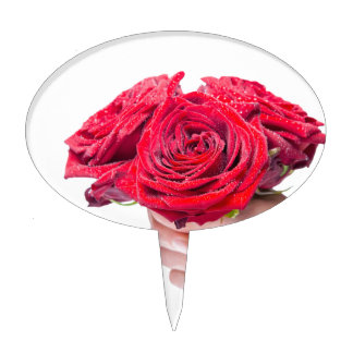 Hand holding red roses with water drops cake topper