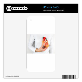 Hand holds human heart model at body iPhone 4S decals