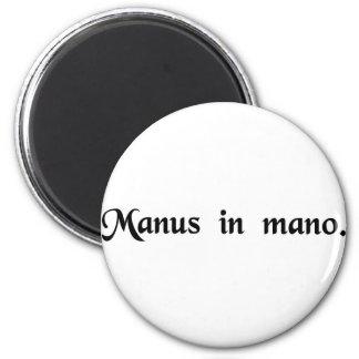 Hand in hand. 2 inch round magnet
