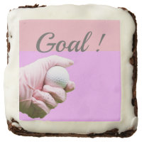 Hand is holding golf ball with word Goal Brownie