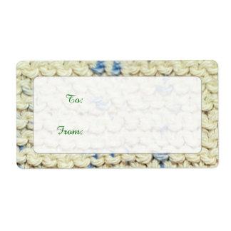 Hand Knit Garter Stitch with Cream and Blue Yarn Label