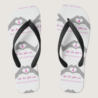 Hand making heart sign with breast cancer ribbon flip flops