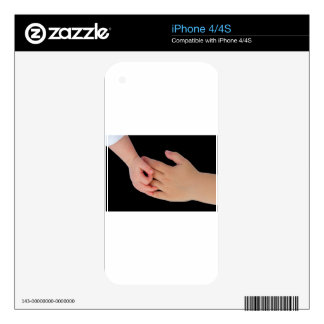Hand of baby touching hand of child iPhone 4 skins