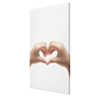Hand of child who made shape of heart canvas print