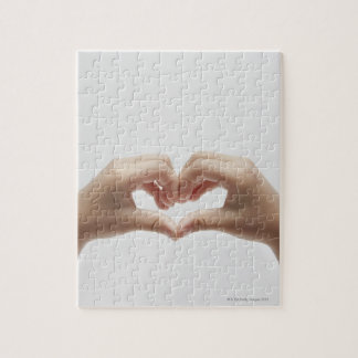 Hand of child who made shape of heart jigsaw puzzle