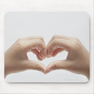 Hand of child who made shape of heart mouse pad