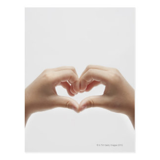 Hand of child who made shape of heart postcard