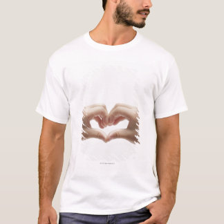 Hand of child who made shape of heart T-Shirt