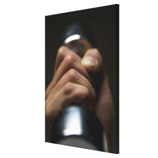 Hand of person lifting weights canvas print