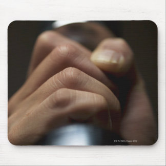 Hand of person lifting weights mouse pad