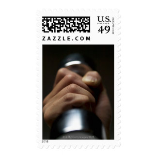 Hand of person lifting weights postage stamp