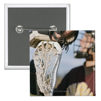 Hand on a Lacrosse Stick Button