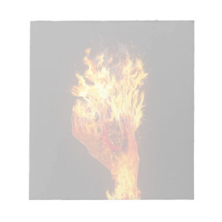 Hand on fire notepad