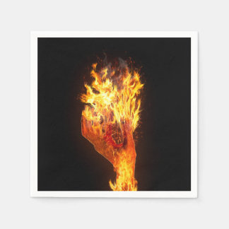 Hand on fire paper napkin