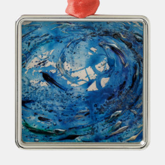 Hand painted tumbling surf wave with silvery fish metal ornament