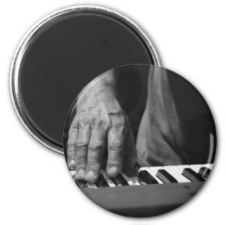 hand playing keyboard bw male music 2 inch round magnet
