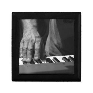hand playing keyboard bw male music gift box