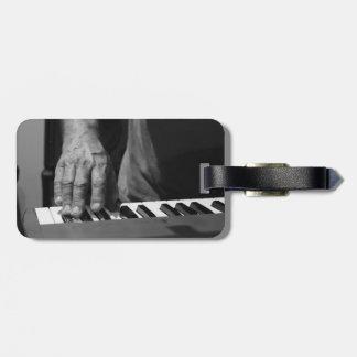 hand playing keyboard bw male music luggage tag
