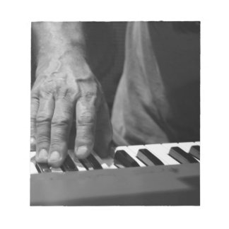 hand playing keyboard bw male music notepad